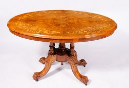 A VICTORIAN WALNUT LOO TABLE with satinwood inlaid decoration, turned supports and four cabriole