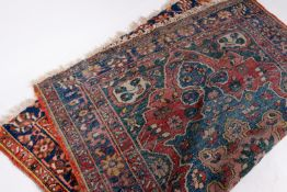 AN OLD BLUE GROUND ORIENTAL RUG with central medallion and triple banded border, 191cm x 150cm At