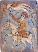AN IZNIK STYLE POTTERY TILE with a figure on horseback, 15cm wide x 20cm high Condition: crazing and