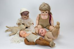 A COLLECTION OF ANTIQUE COMPOSITE HEADED DOLLS and a stuffed toy dog Condition: one doll's head is