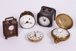 A MINIATURE CARRIAGE TYPE TIMEPIECE OR CLOCK with a Swiss eight day watch type movement and