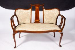AN EDWARDIAN ART NOUVEAU STYLE MAHOGANY SATINWOOD AND MOTHER OF PEARL INLAID SUITE to include a