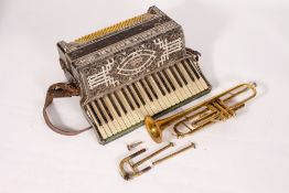 AN OLD TRUMPET in a tatty case together with a Paolo Soprani piano accordion, 48cm wide (2)