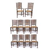 A SET OF TEN OAK AND ASH LADDER BACK DINING CHAIRS with turned stretchers to the front legs and rush