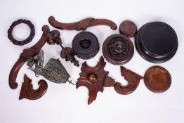 A COLLECTION OF ORIENTAL HARDWOOD STANDS and pot lids together with an Eastern cast metal hanging