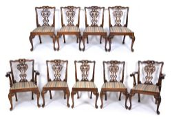 A SET OF NINE CHIPPENDALE STYLE MAHOGANY DINING CHAIRS with upholstered inset seats to include two