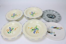SUSIE COOPER (1902-1995) FOR CROWN BURSLEM a set of eight shallow bowls, printed and impressed