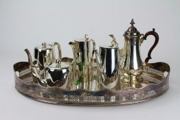 A SILVER PLATED GALLERY OVAL TRAY 60cm wide; a silver plated coffee pot and further silver plated