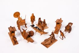 A GROUP OF EIGHT CHINESE SOFTWOOD CARVINGS to include figures transporting a dignitary in sedan