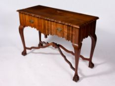 A HARDWOOD SIDE TABLE with a shaped top, two drawers, cabriole legs and claw and ball feet united by