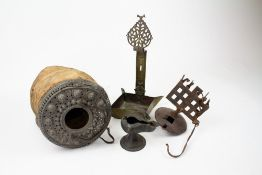 A COLLECTION OF FOUR EASTERN ANTIQUE METAL LAMPS of varying styles including two oil lamps, a
