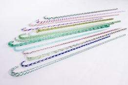A COLLECTION OF FOURTEEN GLASS WALKING STICKS many with decorative coloured spirals to the centre,