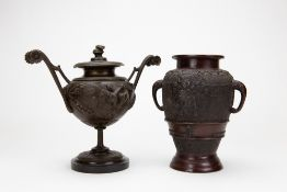 AN ORIENTAL BRONZE URN with elephant trunk handles,19cm in height together with a spelter urn,