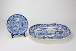 A 19TH CENTURY EDGE, MALKIN & CO BLUE AND WHITE POTTERY SOUP PLATE printed with a view and centred