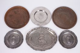 A PAIR OF ANTIQUE PEWTER PLATES embossed with family crests and having touch marks to the reverse,