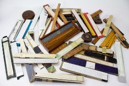 A COLLECTION OF 19TH AND 20TH CENTURY RULES to include a Rabone boxwood rule, J H Steward & Son
