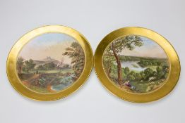 A PAIR OF LATE 19TH CENTURY COALPORT CABINET PLATES painted with a river landscape and Dover