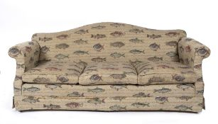 A KINGCOME CAMEL BACK SOFA with scrolling arms and fish themed upholstery, 214cm wide x 90cm deep