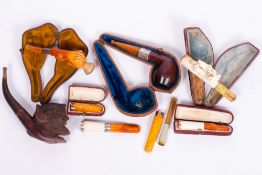 A COLLECTION OF PIPES AND CHEROOT HOLDERS to include a 9 carat gold mounted cheroot holder, 6.5cm in