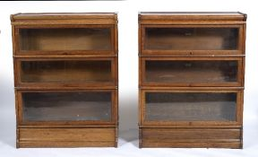 A NEAR PAIR OF OAK GLOBE WERNICKE STYLE THREE TIER GLAZED BOOKCASES one with a label for Simpoles