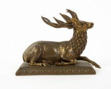 A 19TH CENTURY GILT BRASS SCULPTURE OF A RESTING STAG on a rectangular plinth base, 13.5cm wide x