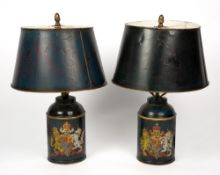 A PAIR OF PAINTED TOLEWARE TABLE LAMPS decorated with the Royal Coat of Arms, each 12cm wide at
