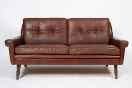 A 1960'S DANISH LIGHT BROWN LEATHER UPHOLSTERED TWO SEATER SETTEE with four turned legs, 145cm