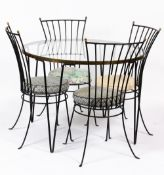 A WROUGHT IRON AND BRASS DINING SUITE consisting of a circular glass inset table with brass rim
