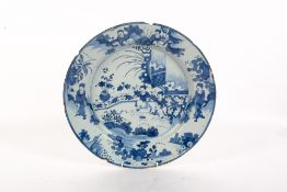 AN EARLY 18TH CENTURY CONTINENTAL BLUE AND WHITE TIN GLAZED CHARGER with Oriental decoration, makers