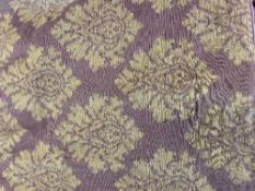 A PAIR OF LARGE FABRIC LINED CURTAINS with purple ground and green floral motifs, each curtain