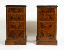 A PAIR OF WALNUT BEDSIDE CHESTS each with four drawers and plinth bases, 43.5cm wide x 56cm deep x