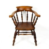 AN ASH AND ELM CAPTAIN'S CHAIR with turned supports, 70cm wide x 50cm deep x 85.5cm high