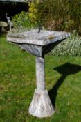 AN ARTS AND CRAFTS STYLE LEAD SUNDIAL with square top and bronze gnomen, on a column support and