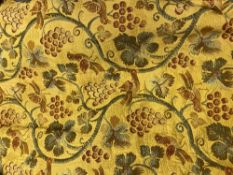 A PAIR OF YELLOW GROUND AND LINED FABRIC CURTAINS decorated with grapevines and birds, each