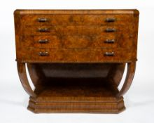 AN ART DECO BURR WALNUT VENEERED CHEST OF FOUR LONG DRAWERS on curving supports and a plinth base,