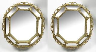 A PAIR OF GILT FRAMED POSSIBLY CONTINENTAL WALL MIRRORS of octagonal form, with central mirror plate