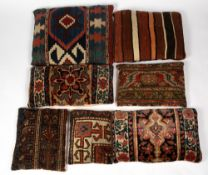 SEVEN CUSHIONS upholstered in Middle Eastern rug fragments to include two Kelim examples, the