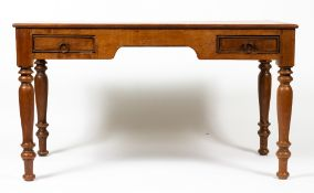 A HARDWOOD DESK with two frieze drawers and turned supports, 135cm wide x 75cm deep x 76cm high