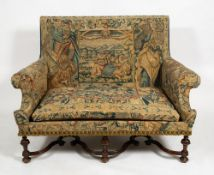 A 19TH CENTURY WILLIAM AND MARY STYLE WALNUT FRAMED SETTEE upholstered in antique Flemish