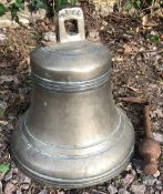 AN OLD BRONZE BELL with iron clapper and suspension ring, 26cm diameter x 28cm high Condition: