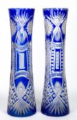 A PAIR OF LARGE 19TH CENTURY BOHEMIAN BLUE CUT GLASS VASES each 14.5cm diameter x 60.5cm in height