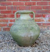 A TERRACOTTA AMPHORA JAR of bulbous form with twin handles, 39cm diameter x 50cm high At present,