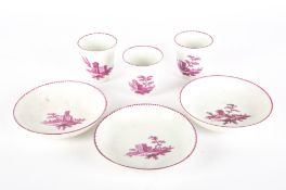 A SET OF THREE 18TH CENTURY VIENNA PORCELAIN COFFEE CUPS AND SAUCERS each decorated with buildings