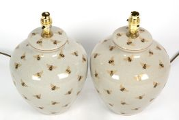 A PAIR OF POTTERY INDIA JANE 'BEE' TABLE LAMPS of ovoid form, 22cm diameter x 34cm high to the top