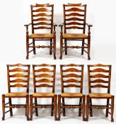 A SET OF EIGHT ASH LADDER BACK DINING CHAIRS with rush seats, turned front legs terminating in pad