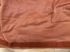 A PAIR OF LARGE RED SILK LINED CURTAINS each 480cm wide at the bottom x 200cm wide at the top x