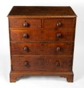 AN 18TH CENTURY CHEST OF TWO SHORT AND THREE LONG DRAWERS with later turned handles and raised on