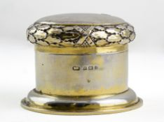 A GEORGE V SILVER GILT DRESSING TABLE BOX by the Duchess of Sutherland's Cripples Guild, the lid