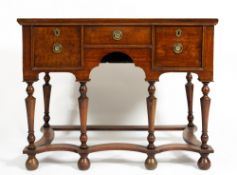 A GEORGE III AND LATER OAK SIDE TABLE with three drawers around a central recess, the turned