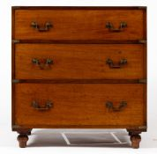A MAHOGANY CAMPAIGN STYLE CHEST OF THREE DRAWERS with brass handles and turned feet, 85cm wide x